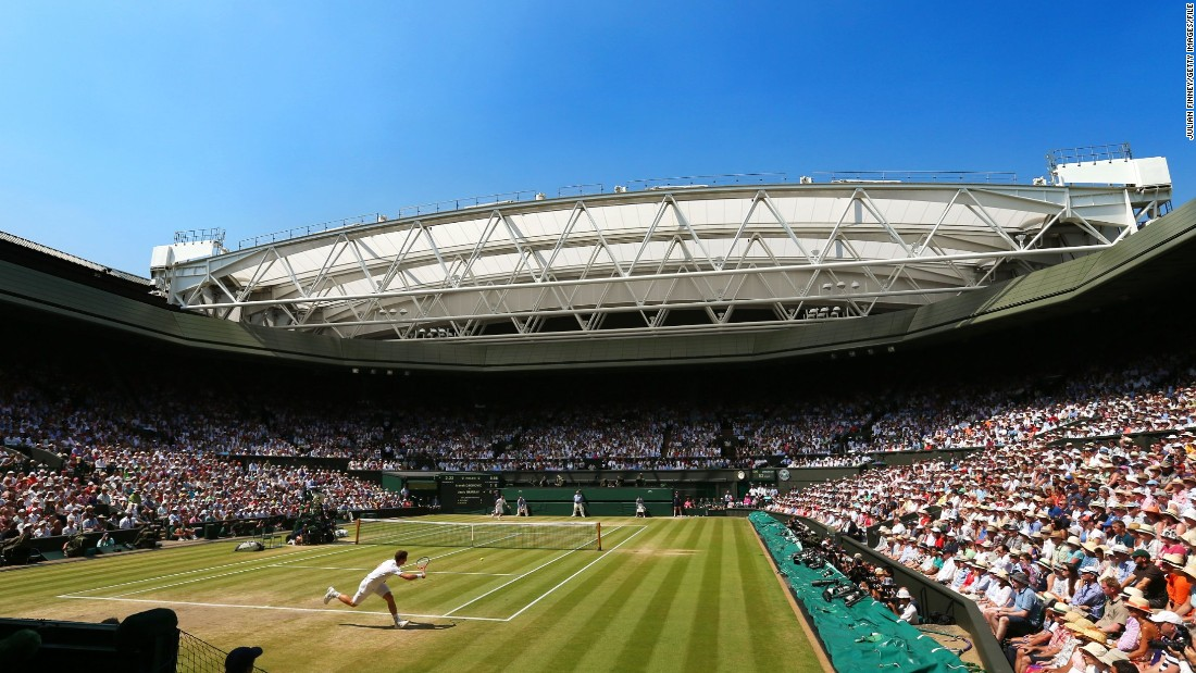 Under bright blue skies, Murray plays a forehand on his way to victory over Novak Djokovic in the 2013 Wimbledon final in front of a capacity 15,000 crowd on Centre Court.