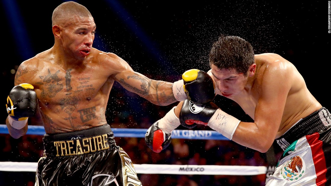 """Caring, compassionate ... and a comedian; he's always joking around in the locker room,"" Theophane says of the undefeated champ who welcomed him into his stable of fighters.  ""I lost my first fight under him but Floyd said, 'Don't worry, we'll get you back there.' So I've had four wins in 12 months, now I'm back on the TV. Floyd is a man of his word."""