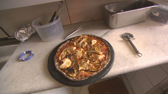 Hailemariam has also created an Ethiopian version of pizza, which also uses teff. Because teff is gluten-free, the dough doesn't have the same elasticity of traditional pizza dough. To combat this, he adds a touch of wheat flour and extra egg. He uses African ingredients and cooks the pizza in a clay oven.
