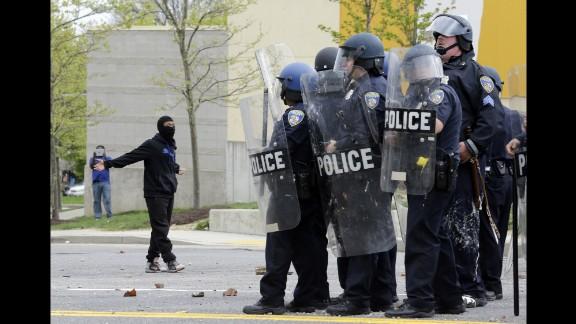 A demonstrator taunts police on April 27.