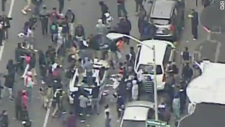 live baltimore protests violent attack police car _00013613