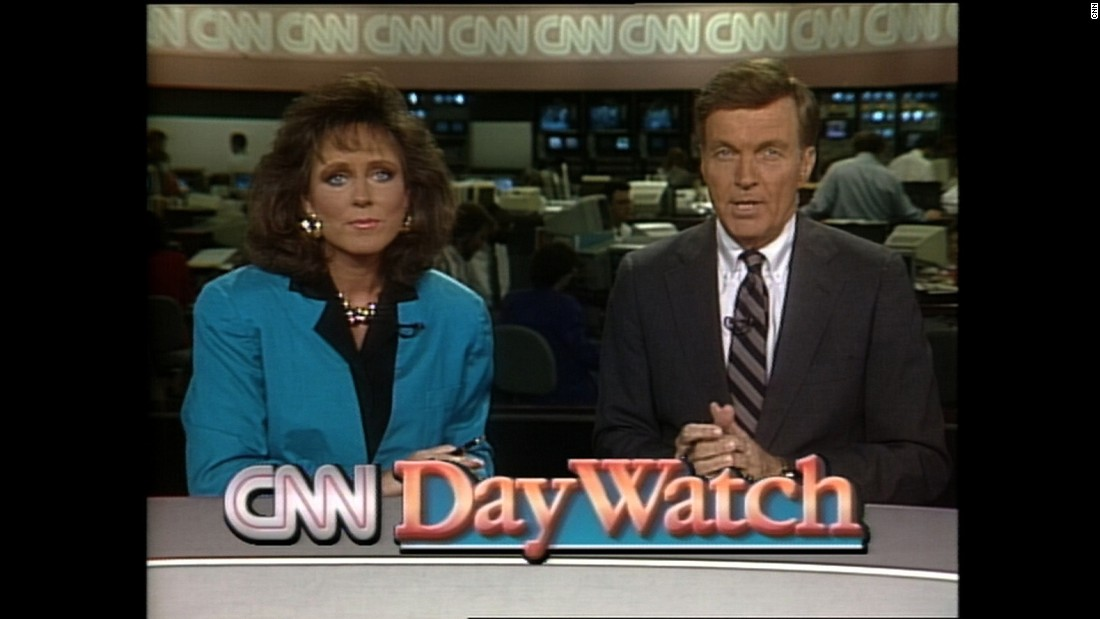 "Mary Anne Loughlin and Ralph Wenge anchor ""CNN Day Watch"" in 1990."