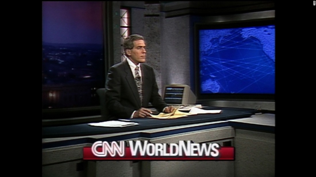 "Ralph Begleiter hosts ""CNN World News"" in 1991. In a 1991 article, The New York Times described CNN's ""revolutionary"" anchor style. ""(T)he folks at CNN look like real people -- untrammeled by the pressing agendas of management consultants, image consultants, personal shoppers and the like,"" <a href=""http://www.nytimes.com/1991/04/28/magazine/beauty-weighing-anchors.html"" target=""_blank"">the article said.</a>"