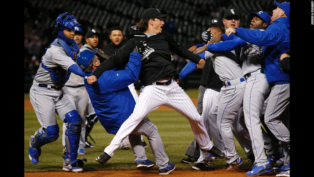 "Chicago White Sox's Jeff Samardzija, center, fights with Kansas City Royals players during the seventh inning on Thursday, April 23, in Chicago. Edinson Volquez of the Royals was suspended five games for the incident in which he threw a punch intended for Samardzija. Also suspended were Kansas City's Lorenzo Cain (two games), Yordano Ventura (seven games) and Kelvin Herrera (two games), as well as Chicago's Chris Sale (five games) and Samardzija (five games), <a href=""http://m.mlb.com/news/article/120832326/royals-pitcher-edinson-volquez-drops-appeal-of-suspension"" target=""_blank"">according to MLB.</a>"