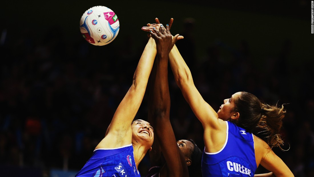 Sulu Tone-Fitzpatrick and Kayla Cullen of the Mystics defend against Romelda Aiken of the Firebirds during a match on Sunday, April 26, in Auckland, New Zealand.