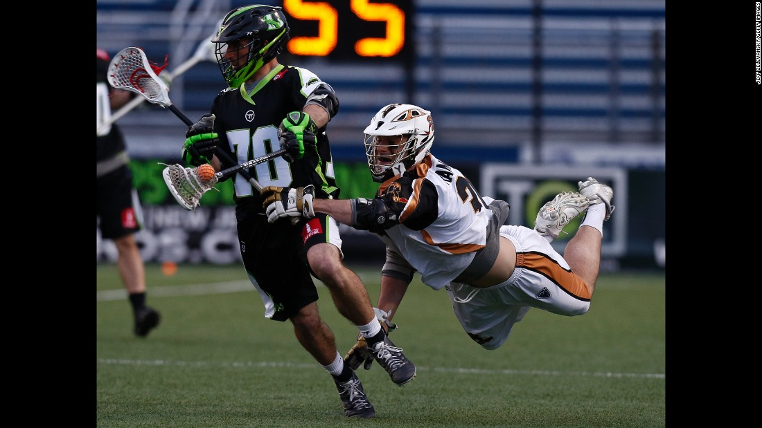 John Ranagan of the Rochester Rattlers chases Steve DeNapoli of New York Lizards in the second half of a lacrosse match on Sunday, April 26, in Hempstead, New York.