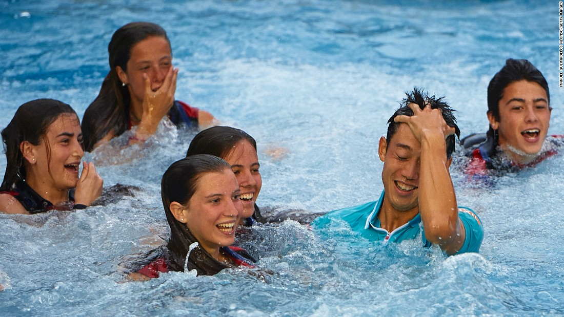 Tennis player Kei Nishikori of Japan jumps into the pool after his victory against Pablo Andujar of Spain, on Sunday, April 26, in Barcelona, Spain.