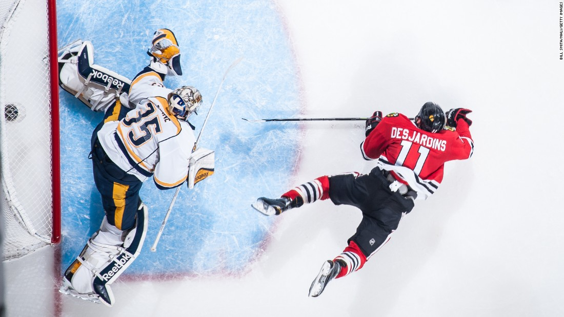 Nashville Predators goalie Pekka Rinne makes a save against a goal attempt by Andrew Desjardins of the Chicago Blackhawks during the 2015 NHL Stanley Cup Playoffs on Tuesday, April 21, in Chicago.