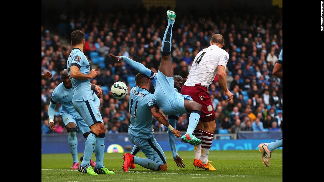 Yaya Toure of Manchester City tangles for the ball with teammate Aleksandar Kolarov and Ron Vlaar of Aston Villa on Saturday, April 25, in Manchester.