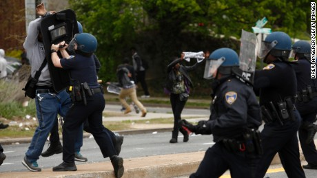 Baltimore Police officers push back a protestor on April 27.