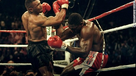 Mike Tyson takes apart British heavyweight boxer Frank Bruno.