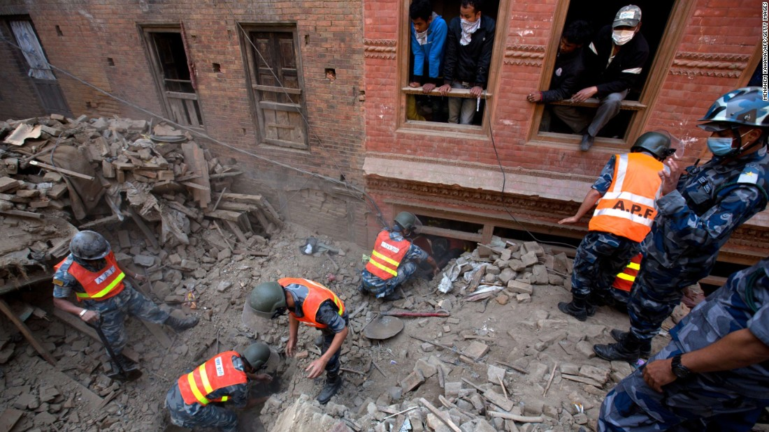 Nepalese military police search through rubble outside Kathmandu on April 28.