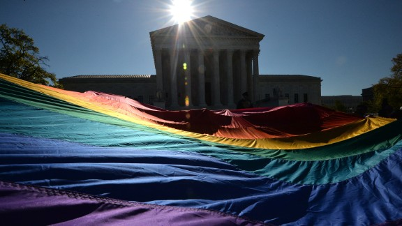 Supporters of same-sex marriages gather outside the U.S. Supreme Court waiting for its decision on April 28, 2015, in Washington.