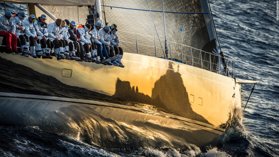 Hovering above the waves in a helicopter, Kurt Arrigo took this photo of  the 112-foot Baltic Nilaya Yacht during the 2012 Rolex Volcano Race. The reflection in the super-yacht's hull shows the Italian island Capri.