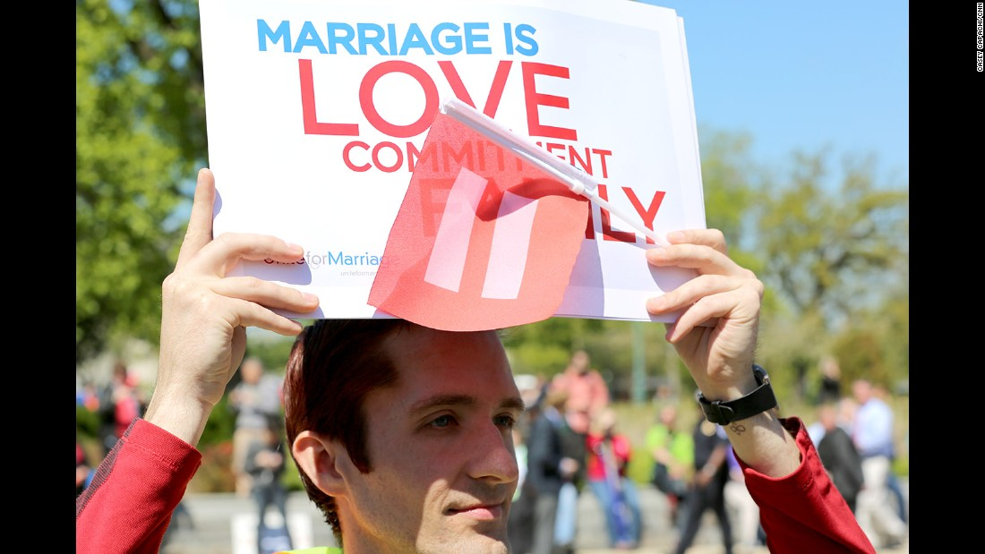 Andrew Zibell of Brooklyn, New York, holds a sign in front of the Supreme Court that shows his support of same-sex marriage.