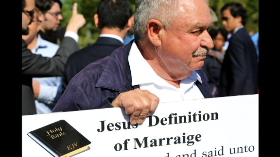 Pastor Larry Hickam holds a sign of what he says is the definition of marriage outside the Supreme Court.