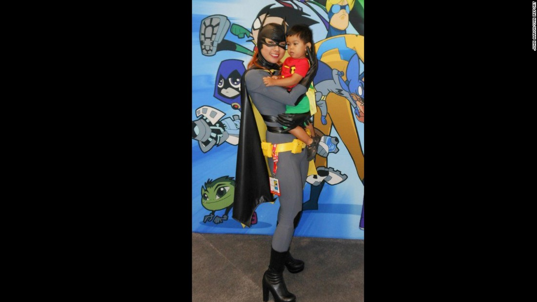 Mother and son make a real dynamic duo as Batgirl and Robin at the San Diego Comic-Con in 2012.