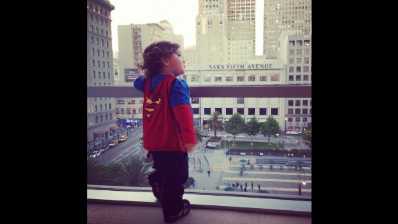 "Keren Espinoza shot this photo of her then 19-month-old son, Jaden, standing on the seventh floor of Macy's in San Francisco last year. The Superman shirt and cape is one of her favorite outfits to put on him. ""I love to see him run and swing at the park; he looks like his cape really makes him fly."""
