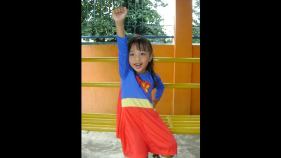 Four-year-old Anthea Ballais of Tacloban, Philippines, is seen here imagining herself soaring through the air as Supergirl.