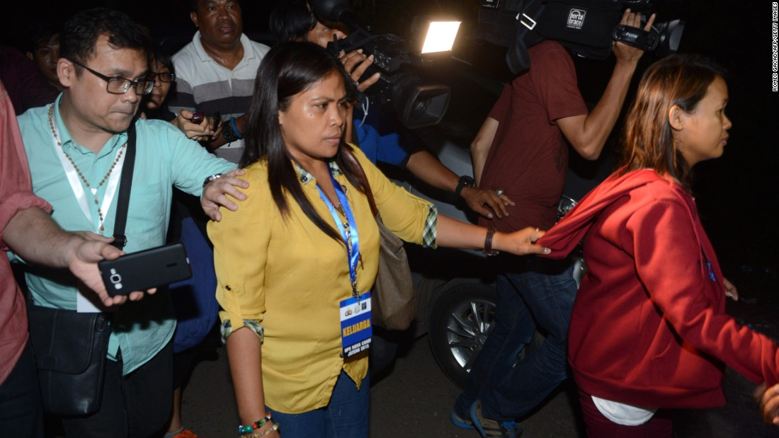 Marites Laurente, center, and Darling Veloso,right, sisters of Filipina drug convict Mary Jane Veloso, arrive at Nusakambangan port in Cilacap after returning from Nusakambangan maximum security prison on April 29. Veloso was spared at the 11th hour after facing execution.