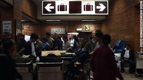Passengers wait for luggage upon arrival at the main international airport in Kathmandu on April 28, 2015.