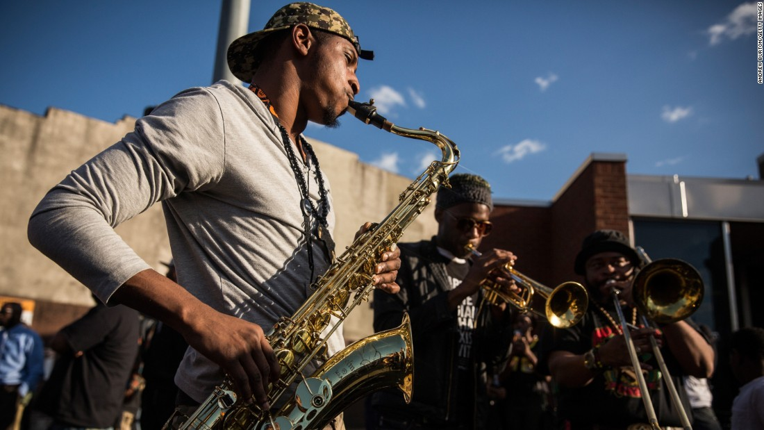 A band plays music during protests on April 28 in Baltimore.