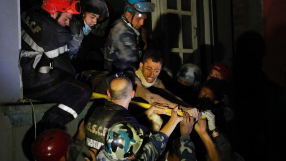 A man is freed from the ruins of a hotel by French rescuers in the Gangabu area of Kathmandu on Tuesday, April 28. Reuters identified the man as Rishi Khanal.