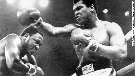 Muhammad Ali, right, and Joe Frazier exchange punches during their 'Thrilla in Manila' bout on October. 1, 1975 in Manila, Philippines. Ali beat Frazier on a TKO in the 14th round.