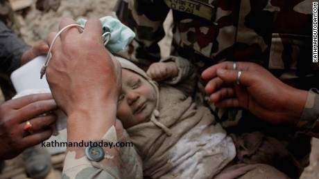A 4-month-old boy was pulled from rubble at least 22 hours after Saturday's earthquake in Nepal.
