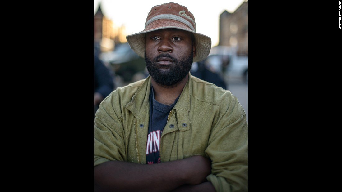 """There were 26 Baltimore citizens forming a human wall, separating the crowd from the police, for their mutual protection,"" Larson says.  He spoke with and took photos of 22 of the participants."