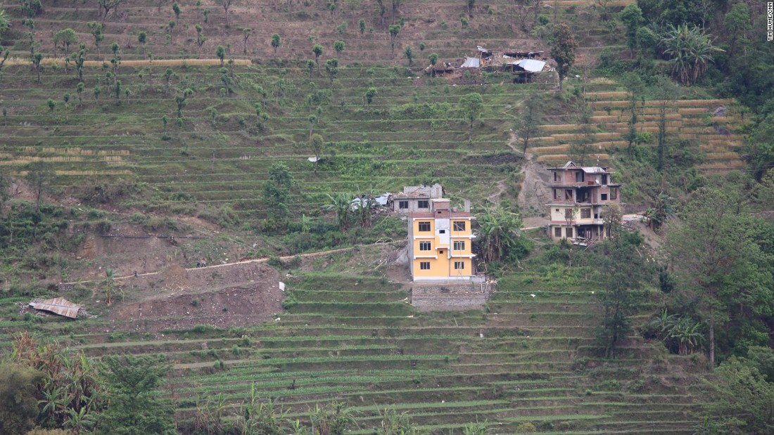 Collapsed buildings among the terraced fields of Melamchi, a village in Sindhupalchok District, central Nepal. Officials say 1,376 people in the district died as a result of the earthquake.