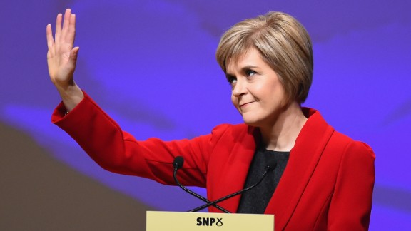 Nicola Sturgeon waves as she gives her first key note speech as SNP party leader at the party