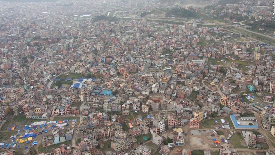 Kathmandu viewed from above. The tents seen at the bottom left house people who have been displaced from their homes because of the quake. Many people in the city are sleeping outside, fearful that their homes could crumble if an aftershock strikes.
