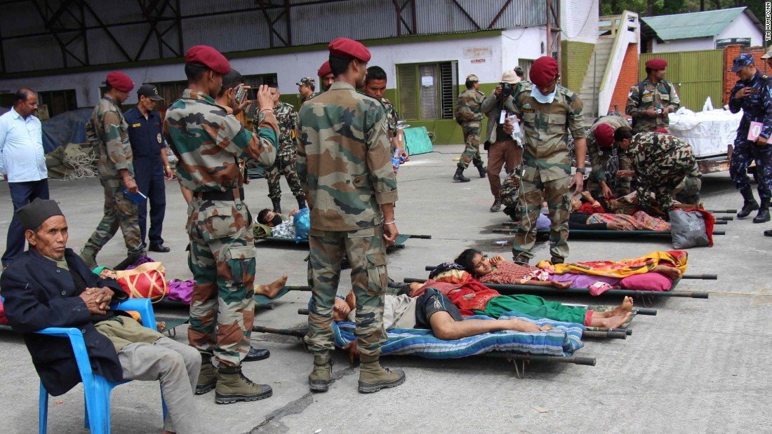 Injured earthquake victims are laid out on stretchers at an emergency army triage center at the air base in Kathmandu.