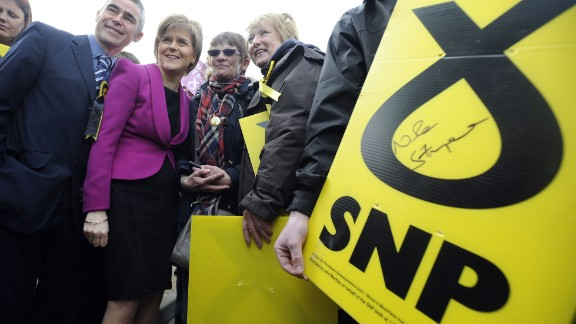 First Minister of Scotland and leader of the SNP Nicola Sturgeon (2L) poses with supporters during a UK general election campaign visit to the Cook School in Kilmarnock, Ayrshire, southwest Scotland on April 27, 2015. Britain goes to the polls on May 7 to elect a new parliamnt. SNP leader Nicola Sturgeon, whose party is expected to win most of Scotland