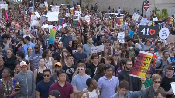 Thousands gather in the streets of Baltimore in a peaceful march and protest.