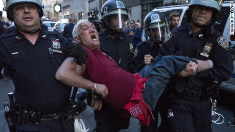 A man is carried by police officers as arrests are made at New York's Union Square on Wednesday.