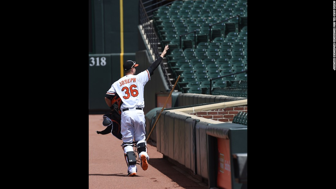 Orioles catcher Caleb Joseph pretends to wave to fans.
