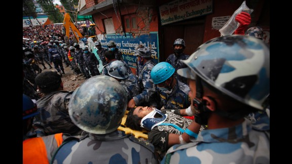 A teenage boy gets rushed to a hospital April 30 after being rescued from the debris of a building in Kathmandu days after the earthquake.