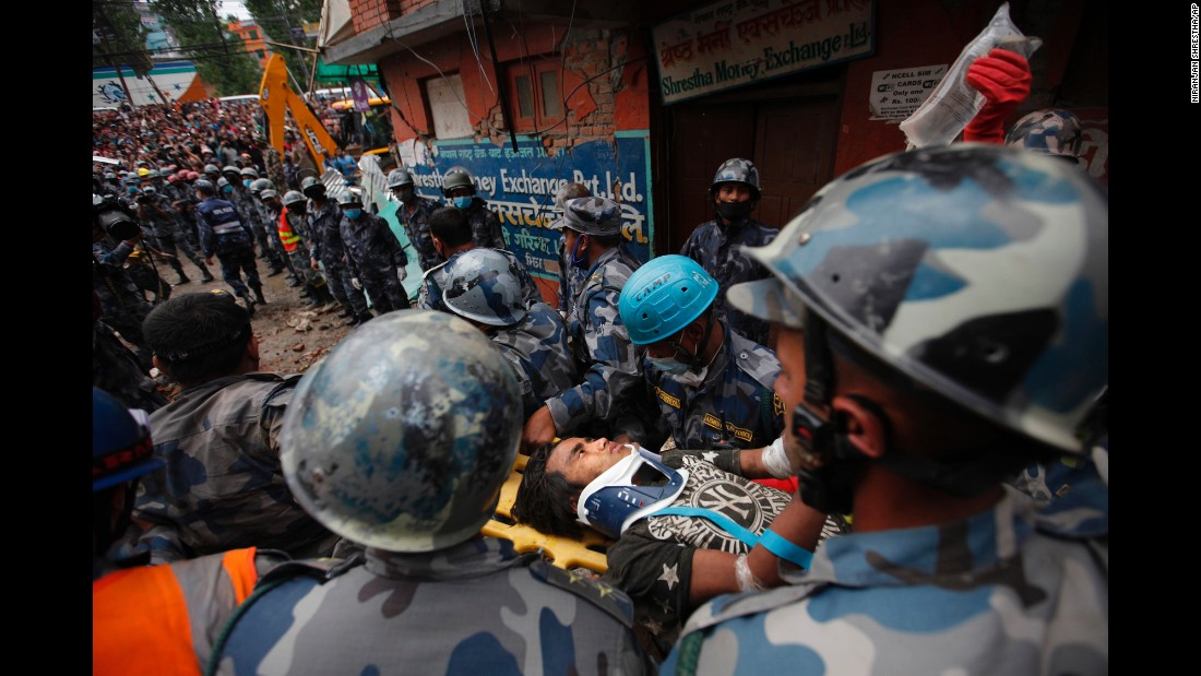 "A teenage boy gets rushed to a hospital April 30 <a href=""http://edition.cnn.com/2015/04/30/asia/nepal-earthquake/index.html"">after being rescued from the debris of a building</a> in Kathmandu days after the earthquake."