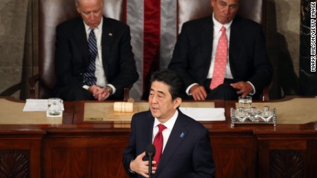 Japanese PM Shinzo Abe speaks to Congress flanked by Vice President Joe Biden (L) and House Speaker John Boehner.