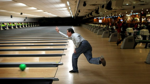 Santorum bowls at Sabre Lanes  in Menasha, Wisconsin, following a campaign rally on April 2, 2012.