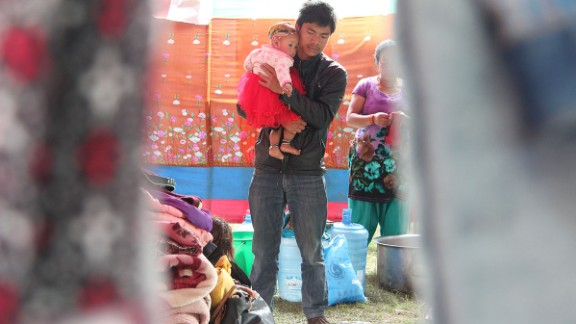 Families have set up portable stoves to cook the little food they get; aid has been slow to reach the encampment.