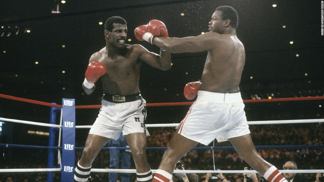 Michael Spinks, left, blocks a punch from Larry Holmes at a heavyweight title fight on September 21, 1985, at the Riviera. Spinks won the fight by a unanimous decision in the 15th round.