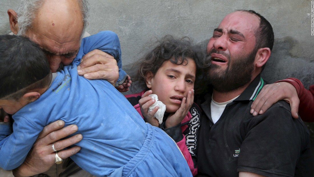 A family mourns the loss of relatives after a bombing in Aleppo on Wednesday, April 29. Activists say forces loyal to Syrian President Bashar al-Assad dropped a barrel bomb.