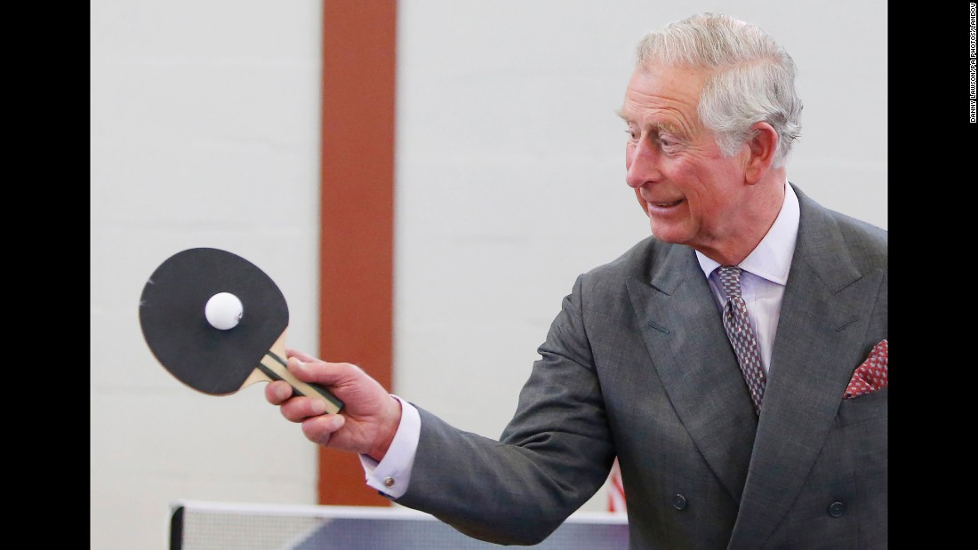 Charles, Prince of Wales, plays table tennis on Wednesday, April 29, during the official opening of a new sports center in Cumnock, Scotland.