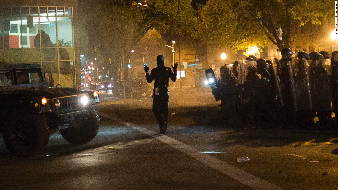 "A community organizer later identified as Joseph Kent paces in front of riot police with his hands up during a curfew in Baltimore on Tuesday, April 28. Moments later, he was <a href=""http://www.cnn.com/videos/us/2015/04/29/ctn-live-cuomo-baltimore-joseph-kent-arrested.cnn"" target=""_blank"">seen live on CNN being arrested by police</a>. His lawyer said Thursday morning that his client <a href=""http://www.cnn.com/2015/04/29/us/baltimore-where-is-joseph-kent/index.html"" target=""_blank"">had been released from jail</a>."