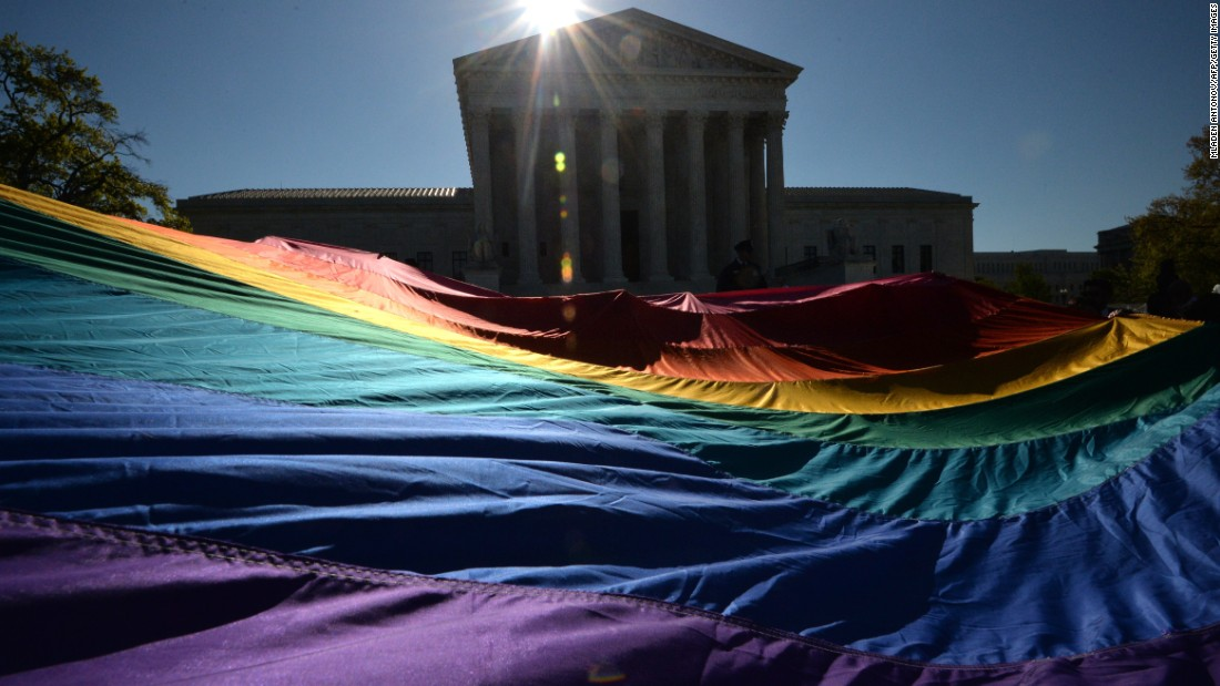 Supporters of same-sex marriage gather outside the U.S. Supreme Court on Tuesday, April 28, in Washington. The court is hearing arguments on whether same-sex couples have a constitutional right to wed.