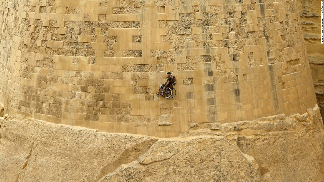 Former British police officer Swasie Turner abseils in a wheelchair down the bastions of Valletta, Malta, on Monday, April 27. Turner has wheeled himself more than 38,000 miles and raised more than $1.5 million for charity since 1997 after losing his wife to cancer, according to local media.