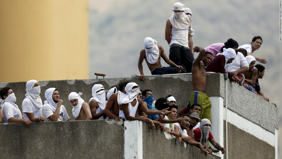 Inmates gather on the roof to protest against overcrowding in a prison in Caracas, Venezuela, on Monday, April 27.